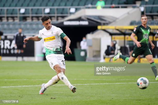 Lars Stindl of Borussia Moenchengladbach scores his team's third goal during the Bundesliga match between Borussia Moenchengladbach and VfL Wolfsburg...