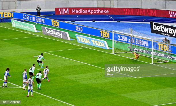 Lars Stindl of Borussia Moenchengladbach scores their team's second goal from the penalty spot during the Bundesliga match between Hertha BSC and...