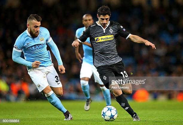 Lars Stindl of Borussia Moenchengladbach takes on Nicolas Otamendi of Manchester City during the UEFA Champions League Group D match between...