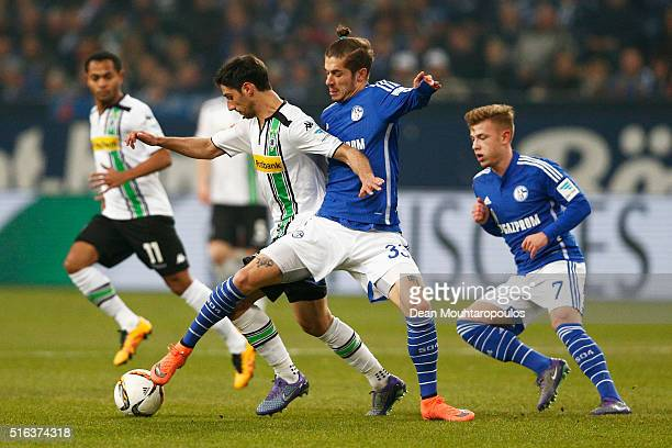 Lars Stindl of Borussia Monchengladbach and Roman Neustadter of Schalke battle for the ball during the Bundesliga match between FC Schalke 04 and...