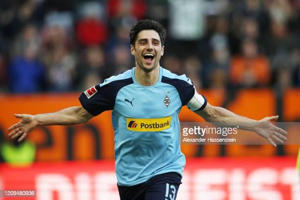 Lars Stindl of Borussia Monchengladbach celebrates after scoring his team's third goal during the Bundesliga match between FC Augsburg and Borussia...