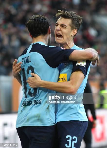 Lars Stindl of Borussia Monchengladbach celebrates after scoring his team's third goal with Florian Neuhaus during the Bundesliga match between FC...
