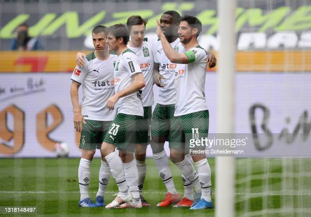 Lars Stindl of Borussia Monchengladbach celebrates with team mates after scoring their side's first goal during the Bundesliga match between Borussia...