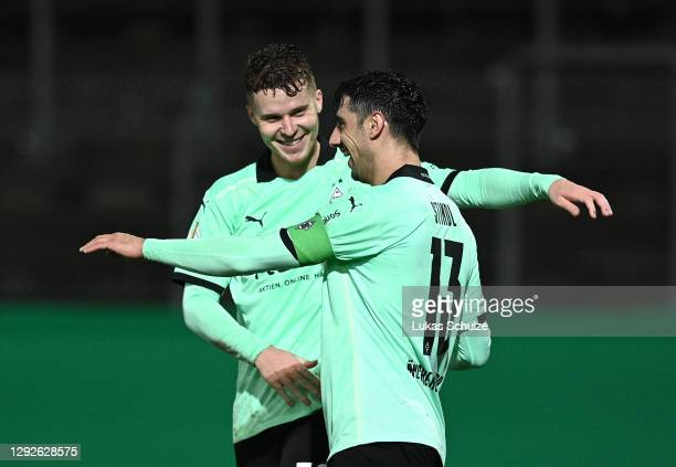 Lars Stindl of Borussia Monchengladbach celebrates with teammate Nico Elvedi after scoring their team's third goal during the DFB Cup second round...