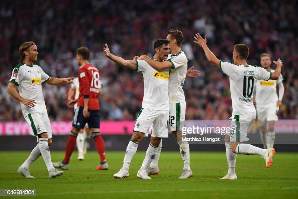 Lars Stindl of Borussia Monchengladbach celebrates with teammates after scoring his team's second goal during the Bundesliga match between FC Bayern...