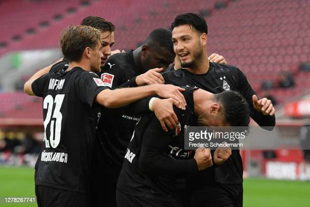 Lars Stindl of Borussia Monchengladbach celebrates with teammates after scoring his team's third goal during the Bundesliga match between 1. FC Koeln...