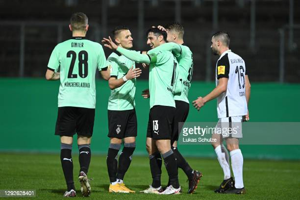Lars Stindl of Borussia Monchengladbach celebrates with teammates Hannes Wolf and Matthias Ginter after scoring their team's third goal during the...