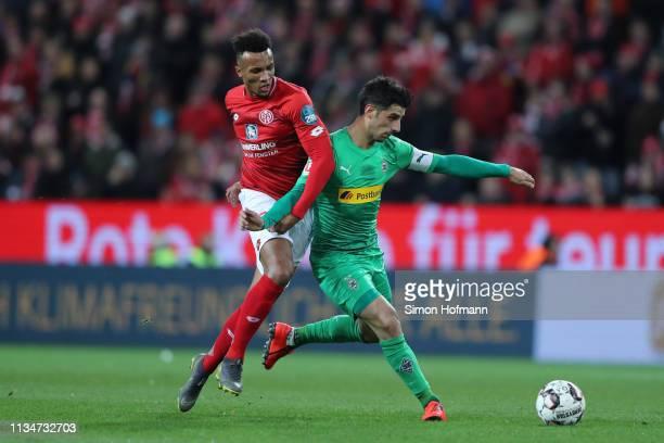 Lars Stindl of Borussia Monchengladbach is challenged by Jean-Philippe Gbamin of FSV Mainz during the Bundesliga match between 1. FSV Mainz 05 and...