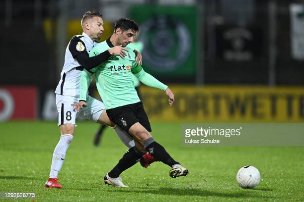 Lars Stindl of Borussia Monchengladbach is challenged by Luca Durholtz of SV Elversberg during the DFB Cup second round match between SV Elversberg...