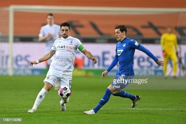Lars Stindl of Borussia Monchengladbach is challenged by Sebastian Rudy of Hoffenheim during the Bundesliga match between Borussia Moenchengladbach...