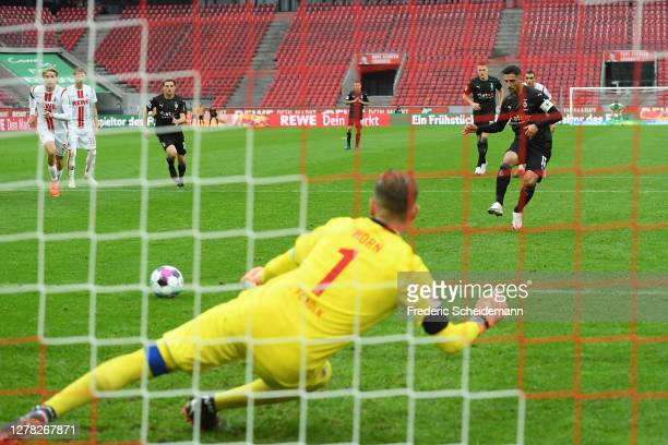Lars Stindl of Borussia Monchengladbach scores a penalty for his team's third goal past Timo Horn of 1. FC Koln during the Bundesliga match between...