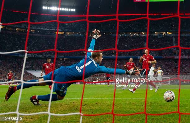Lars Stindl of Borussia Monchengladbach scores his team's second goal past Goalkeeper Manuel Neuer of FC Bayern Muenchen during the Bundesliga match...