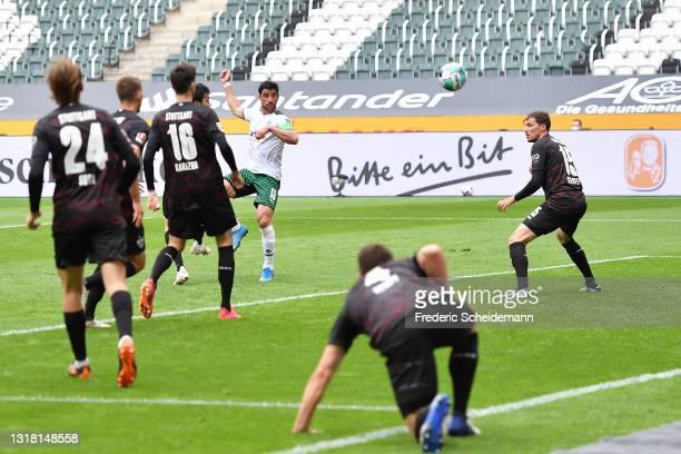 Lars Stindl of Borussia Monchengladbach scores their side's first goal during the Bundesliga match between Borussia Moenchengladbach and VfB...