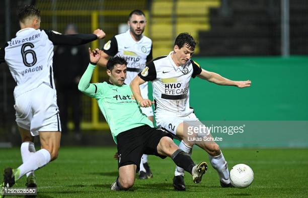 Lars Stindl of Borussia Monchengladbach scores their sides third goal as Lukas Kohler of SV Elversberg challenges during the DFB Cup second round...