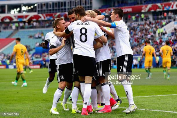 Lars Stindl of Germany is mobbed by his teammates after scoring the opening goal during the FIFA Confederations Cup Russia 2017 Group B match between...