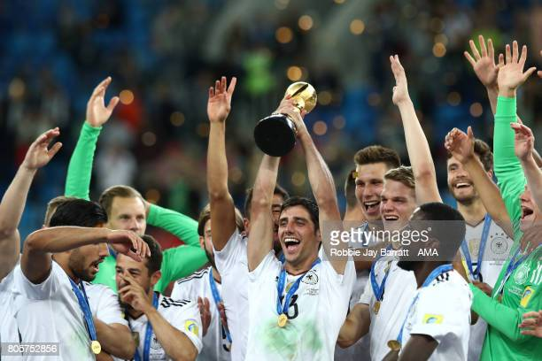 Lars Stindl of Germany lifts the trophy with his teammates at the end of the FIFA Confederations Cup Russia 2017 Final match between Chile and...