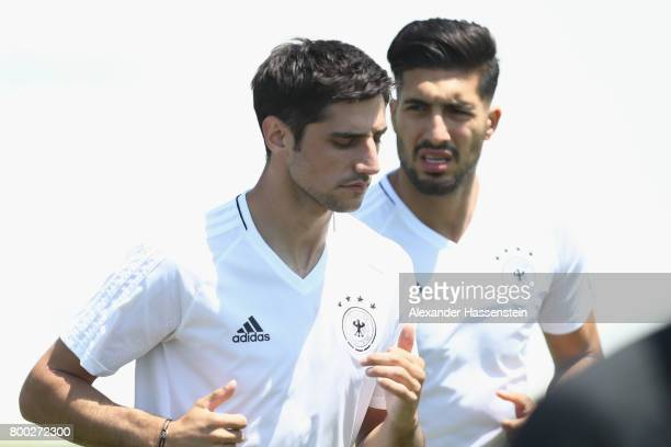 Lars Stindl of Germany runs with his team mate Emre Can during a Germany training session ahead of their FIFA Confederations Cup Russia 2017 Group B...