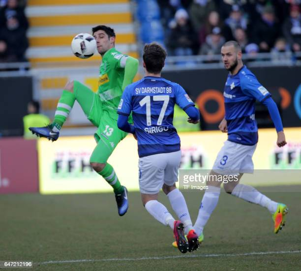 Lars Stindl of Gladbach and Sandro Sirigu of Darmstadt and Alexander Milosevic of Darmstadt battle for the ball during the Bundesliga match between...