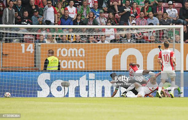 Lars Stindl of Hannover 96 scores the winning goal during the Bundesliga match between FC Augsburg and Hannover 96 at SGL Arena on May 16 2015 in...
