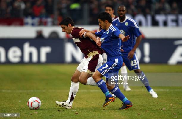 Lars Stindl of Hannover and Josue of Wolfsburg battle for the ball during the Bundesliga match between Hannover 96 and VfL Wolfsburg at AWD Arena on...