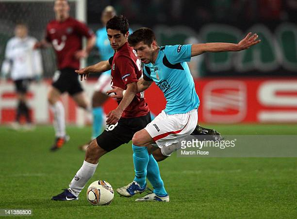 Lars Stindl of Hannover and Sebastien Pocognoli of Liege battle for the ball during the UEFA Europa League second leg round of 16 match between...