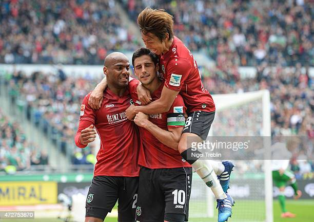 Lars Stindl of Hannover celebrates scoring his goal with Jimmy Briand and Hiroshi Kiyotake during the Bundesliga match between Hannover 96 and SV...