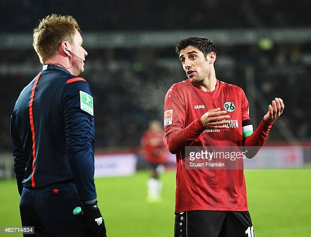 Lars Stindl of Hannover reacts to the challenge by Gonzalo Alejandro Jara of Mainz during the Bunsliga match between Hannover 96 and 1 FSV Mainz 05...