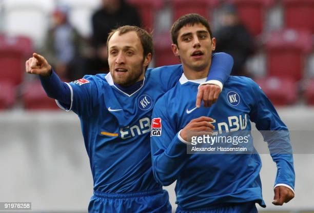 Lars Stindl of Karlsruhe celebrates scoring his first team goal with his team captain Alexander Iashvili during the Second Bundesliga match between...
