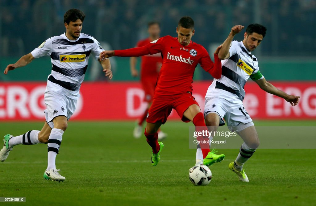 Lars Stindl (R) of Moenchengladbach and Branimir Hrgota of Frankfurt battle for the ball during the DFB Cup semi final match between Borussia Moenchengladbach and Eintracht Frankfurt at Borussia-Park on April 25, 2017 in Moenchengladbach, Germany.