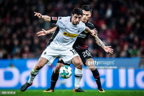 Lars Stindl of Moenchengladbach and Charles Aranguiz of Leverkusen in action during the Bundesliga match between Bayer 04 Leverkusen and Borussia...