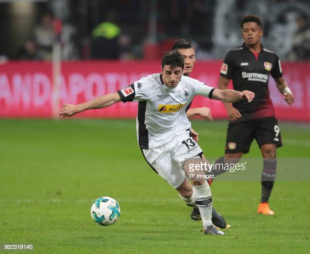 Lars Stindl of Moenchengladbach and Charles Aranguiz of Leverkusen battle for the ball during the Bundesliga match between Bayer 04 Leverkusen and...