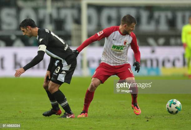Lars Stindl of Moenchengladbach and Daniel Baier of Augsburg battle for the ball during the Bundesliga match between Borussia Moenchengladbach and FC...