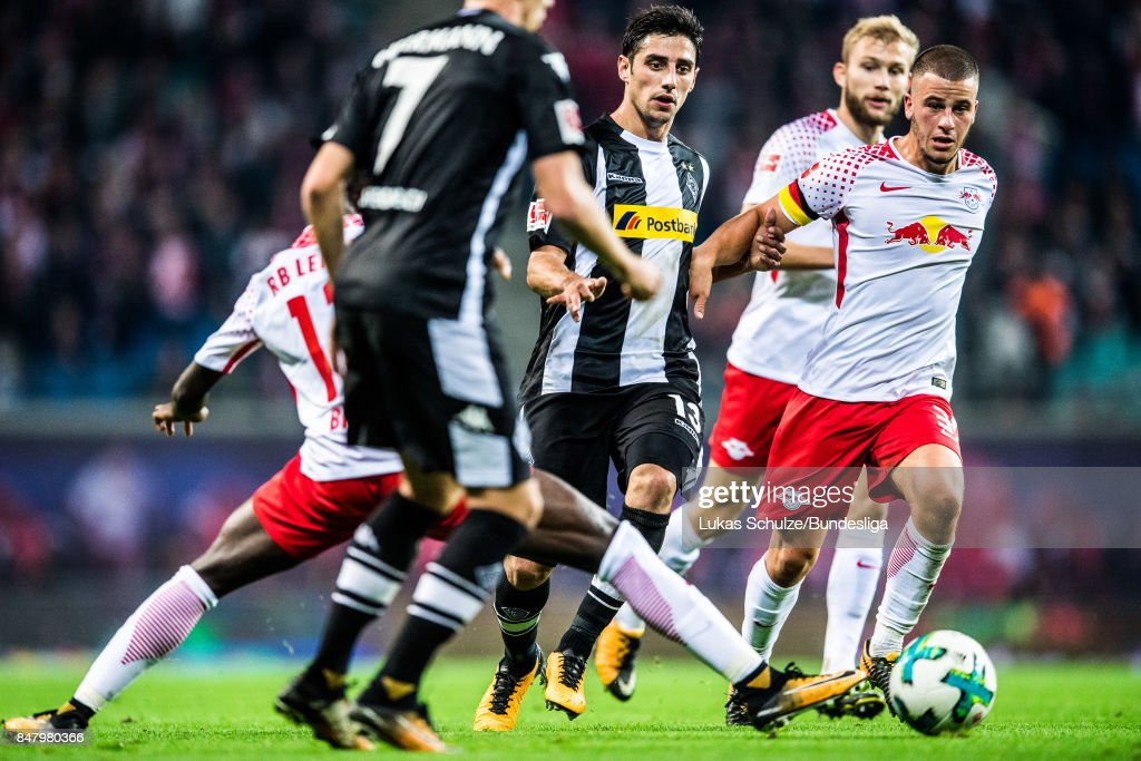 Lars Stindl (L) of Moenchengladbach and Diego Demme (R) of Leipzig in action during the Bundesliga match between RB Leipzig and Borussia Moenchengladbach at Red Bull Arena on September 16, 2017 in Leipzig, Germany.