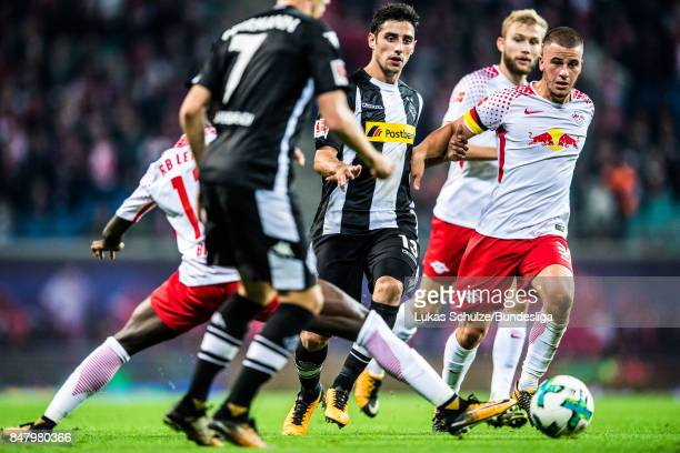Lars Stindl of Moenchengladbach and Diego Demme of Leipzig in action during the Bundesliga match between RB Leipzig and Borussia Moenchengladbach at...