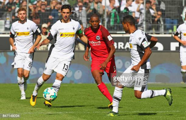Lars Stindl of Moenchengladbach and Gelson Fernandes of Frankfurt battle for the ball during the Bundesliga match between Borussia Moenchengladbach...