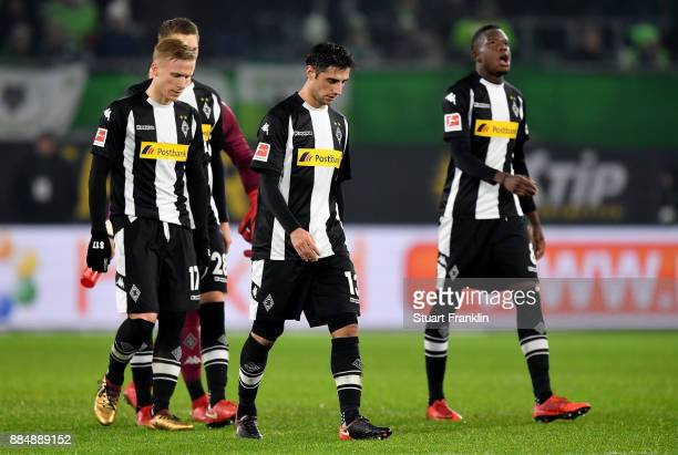 Lars Stindl of Moenchengladbach and his team mates walk off dejected after the Bundesliga match between VfL Wolfsburg and Borussia Moenchengladbach...