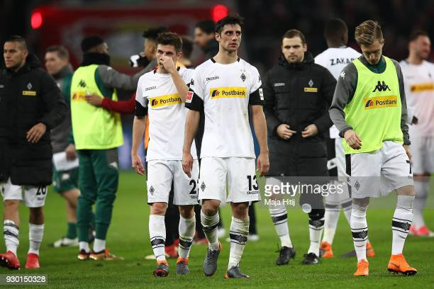 Lars Stindl of Moenchengladbach and players of Moenchengladbach look dejected after the Bundesliga match between Bayer 04 Leverkusen and Borussia...