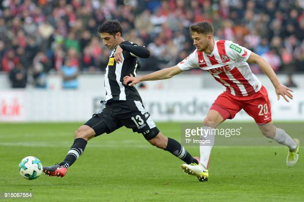 Lars Stindl of Moenchengladbach and Salih Oezcan of Koeln battle for the ball during the Bundesliga match between 1 FC Koeln and Borussia...