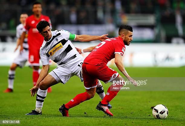 Lars Stindl of Moenchengladbach battles for the ball with Danny Latza of Mainz during the Bundesliga match between Borussia Moenchengladbach and 1...