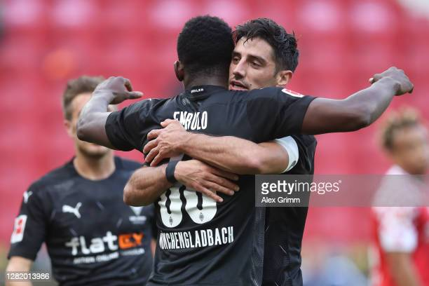 Lars Stindl of Moenchengladbach celebrates his team's first goal with teammate Breel Embolo during the Bundesliga match between 1 FSV Mainz 05 and...