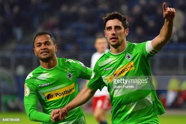 Lars Stindl of Moenchengladbach celebrates his team's first goal with team mate Raffael during the DFB Cup quarter final between Hamburger SV and...
