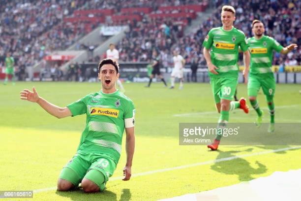 Lars Stindl of Moenchengladbach celebrates his team's third goal during the Bundesliga match between 1 FC Koeln and Borussia Moenchengladbach at...