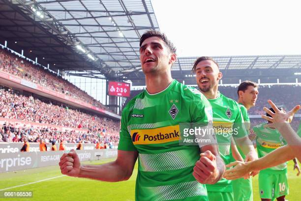 Lars Stindl of Moenchengladbach celebrates his team's third goal with team mate Josip Drmic during the Bundesliga match between 1 FC Koeln and...