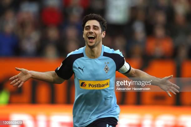 Lars Stindl of Moenchengladbach celebrates scoring the 3rd team goal during the Bundesliga match between FC Augsburg and Borussia Moenchengladbach at...