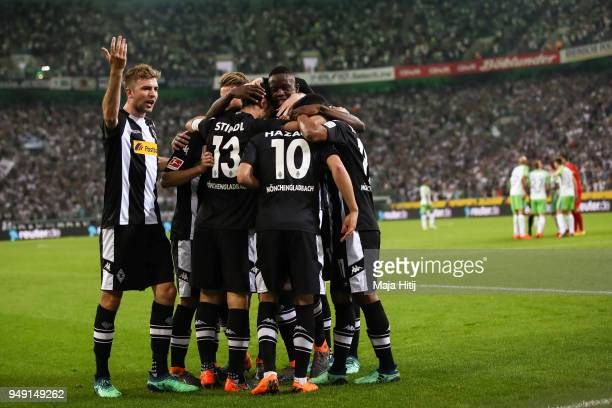 Lars Stindl of Moenchengladbach celebrates with his teammates after scoring his teams first goal to make it 10 during the Bundesliga match between...