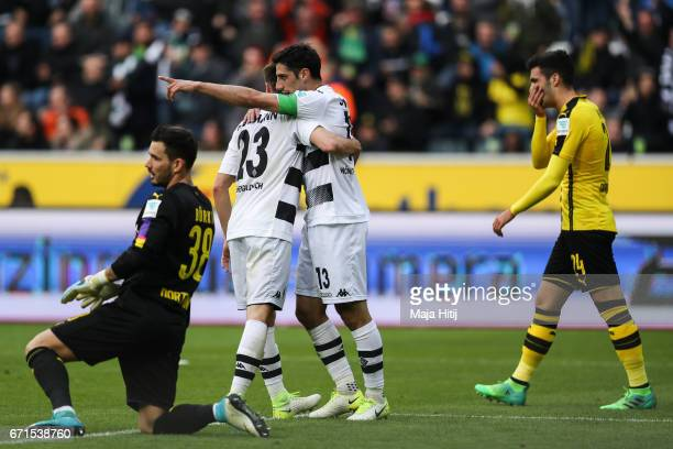 Lars Stindl of Moenchengladbach celebrates with Jonas Hofmann after scoring goal to make it 11 during the Bundesliga match between Borussia...