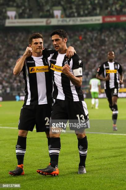 Lars Stindl of Moenchengladbach celebrates with Jonas Hofmann after scoring his teams first goal to make it 10 during the Bundesliga match between...