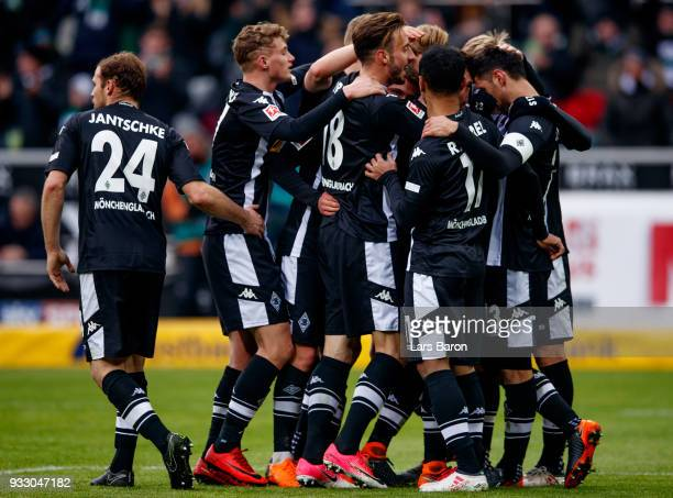 Lars Stindl of Moenchengladbach celebrates with team mates after scoring his teams seconds goal during the Bundesliga match between Borussia...