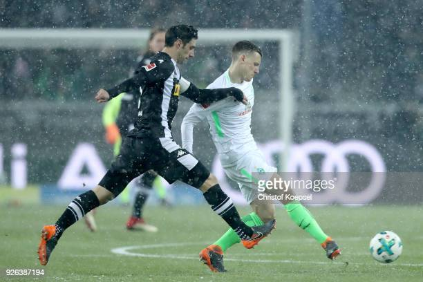Lars Stindl of Moenchengladbach challenges Maximilian Eggestein of Bremen during the Bundesliga match between Borussia Moenchengladbach and SV Werder...