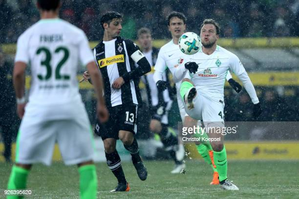 Lars Stindl of Moenchengladbach challenges Philipp Bargfrede of Bremen during the Bundesliga match between Borussia Moenchengladbach and SV Werder...